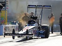 Sep 14, 2013; Charlotte, NC, USA; NHRA top fuel dragster driver Chris Karamesines during qualifying for the Carolina Nationals at zMax Dragway. Mandatory Credit: Mark J. Rebilas-