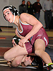 Tommy Cox of Deer Park, top, battles Marc Traficante of Lindenhurst at 106 pounds during the Suffolk County varsity wrestling Division I semifinals at Hofstra University on Sunday, February 15, 2015. Cox won the match by decision.<br /> <br /> James Escher