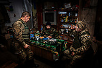 Pisky, Nr Avdiivka, eastern Ukraine, Nov. 2017.<br /> <br /> Servicemen in the Ukrainian army, at a military outpost in the devastated village of Pisky, on the outskirts of Avdiivka in eastern Ukraine.<br /> <br /> The outpost is on the front-line and under frequent attack by sniper, rocket and artillery fire from pro-Russian separatists.