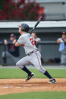 Jake Lanning (26) of the Danville Braves follows through on his swing against the Burlington Royals at Burlington Athletic Park on July 12, 2015 in Burlington, North Carolina.  The Royals defeated the Braves 9-3. (Brian Westerholt/Four Seam Images)