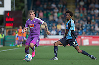 Gregg Wylde of Plymouth Argyle moves past Sido Jombati of Wycombe Wanderers during the Sky Bet League 2 match between Wycombe Wanderers and Plymouth Argyle at Adams Park, High Wycombe, England on 12 September 2015. Photo by Andy Rowland.