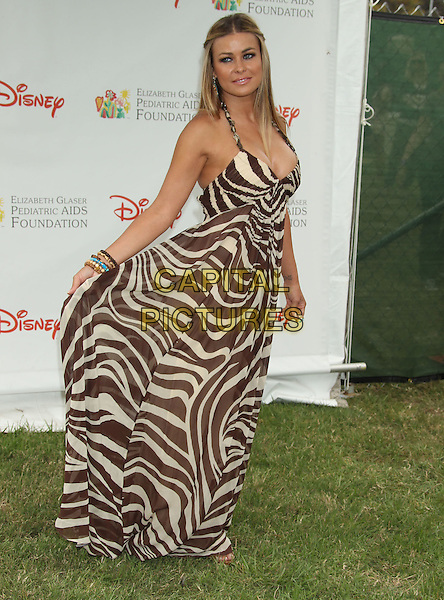 CARMEN ELECTRA .2010 A Time For Heroes Celebrity Picnic held at the Wadsworth Great Lawn, Los Angeles, CA, USA, 13th June 2010..full length brown cream long maxi animal print zebra dress halterneck bracelets holding .CAP/ADM/MJ.©Michael Jade/AdMedia/Capital Pictures.