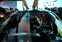 Li Shufu, president of Geely Automobile Holdings Ltd., on a electric car at the Beijing Auto Show in Beijing, China. The car show has attracted all the world's major auto markers. China's vehicle sales have breached the 10-million barrier for the first time ever, with 10.9 million automobiles sold last year. .23 Apr 2010