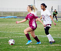 Westside Eagle Observer/RANDY MOLL<br /> Gentry junior Emmi Hays moves the ball away from a visiting Huntsville defender on March 3.