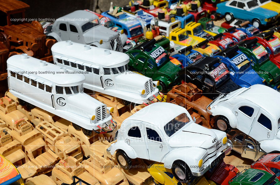 MADAGASCAR, city Antananarivo, street vendor sells small toy cars Citroën 2CV and miniature of vintage railcar La Micheline with tube tyres recycled from used beverage cans / MADAGASKAR Hauptstadt Antananarivo, Strassenverkaeufer verkauft Spielzeug Autos der Citroën 2CV Ente und den Miniatur Triebwagen mit luftbereiften Gummireifen La Micheline aus Blech von recycelten Getraenkedosen