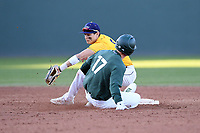 Bryce Kelley (17) of the Michigan State Spartans is safe as second baseman Alex Haba (5) of the Merrimack Warriors takes the throw in a game on Saturday, February 22, 2020, at Fluor Field at the West End in Greenville, South Carolina. Merrimack won, 7-5. (Tom Priddy/Four Seam Images)