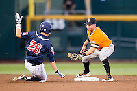 Oklahoma State Cowboys shortstop Donnie Walton (5) applies the tag to Arizona Wildcats baserunner Kyle Lewis (28) during during a steal attempt in Game 6 of the NCAA College World Series on June 20, 2016 at TD Ameritrade Park in Omaha, Nebraska. Oklahoma State defeated Arizona 1-0. (Andrew Woolley/Four Seam Images)