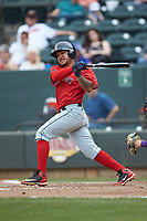 Carlos Tovar (11) of the Salem Red Sox follows through on his swing against the Winston-Salem Dash at BB&T Ballpark on April 22, 2018 in Winston-Salem, North Carolina.  The Red Sox defeated the Dash 6-4 in 10 innings.  (Brian Westerholt/Four Seam Images)
