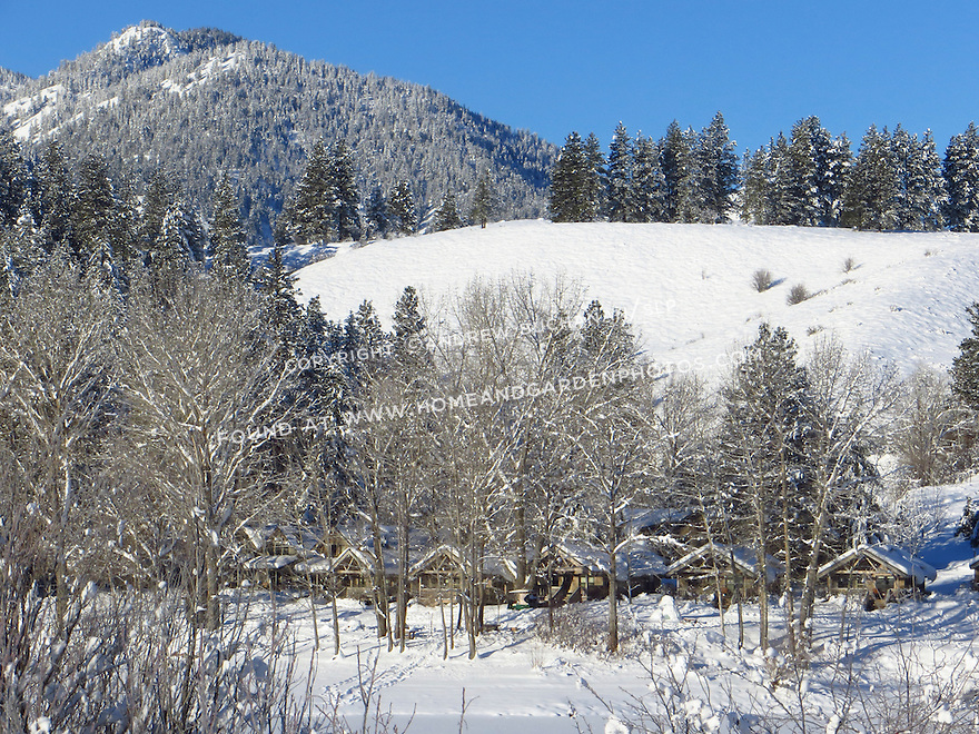 A row of cabins sits tucked among the trees on a beautiful winter morning in the Methow Valley, Washington.
