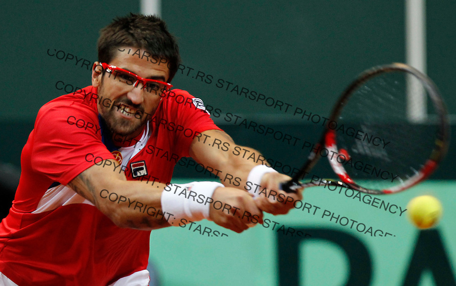 Davis Cup.Czech Republic Vs. Serbia.Janko Tipsarevic Vs. Tomas Berdych.Janko Tipsarevic returnes the ball.Prague, 08.04.2012..foto: Srdjan Stevanovic/Starsportphoto ©