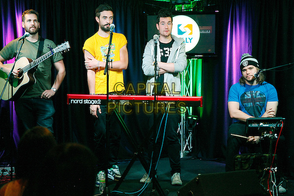 Bastille visit Radio 104.5 performance theater in Bala Cynwyd, PA., USA.<br /> September 29th, 2013 <br /> on stage in concert live gig performance performing music full length guitar keyboards band group beard facial hair green yellow grey gray blue t-shirt  Dan Smith, Chris 'Woody' Wood, Kyle Simmons, Will Farquarson<br /> CAP/MPI/STA<br /> &copy;Star Shooter/MediaPunch/Capital Pictures