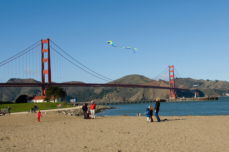 California, San Francisco: Family flying a kite at Crissy Field, near the Golden Gate Bridge..Photo #:1-casanf76383.Photo © Lee Foster 2008
