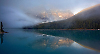 Mist-shrouded Wenkchemma glacier reflecting in Moraine Lake at sunrise- Panorama