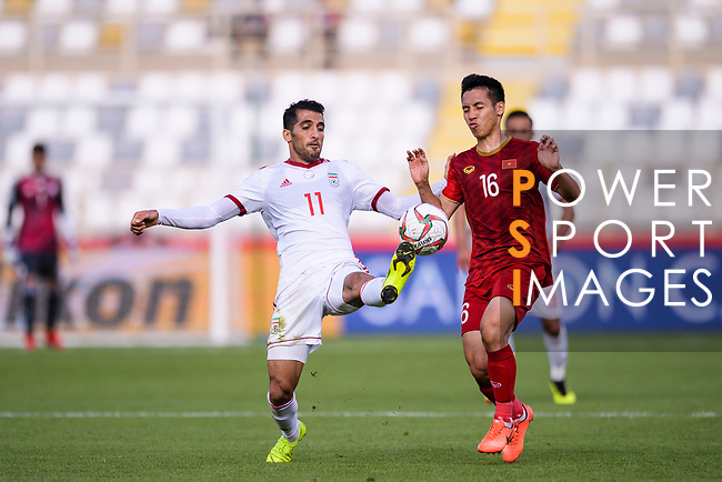 Vahid Amiri of Iran (L) fights for the ball with Do Hung Dung of Vietnam (R) during the AFC Asian Cup UAE 2019 Group D match between Vietnam (VIE) and I.R. Iran (IRN) at Al Nahyan Stadium on 12 January 2019 in Abu Dhabi, United Arab Emirates. Photo by Marcio Rodrigo Machado / Power Sport Images