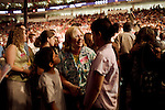"""Sunday, June 24, Raleigh, North Carolina..California evangelist Greg Laurie, brought his """"Harvest Crusade"""" to the RBC Center in Raleigh, NC for 3 days of music. prayer and Christian evangelism. Laurie brought together 200 local churches to sponsor the event which used 3000 volunteers and hopes to convert many newcomers to his version of born again Christianity.. Those attendees wishing to be saved and born again were asked to come forward to speak to counselors and begin their religious transformation."""