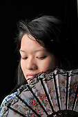 stock photo of an asian woman with Oriental fan