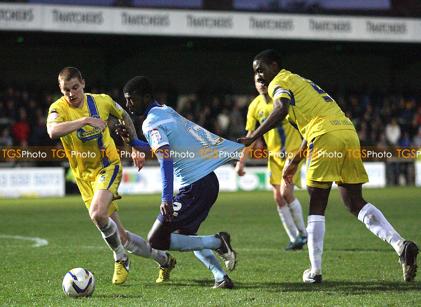 Medy Elito of Dagenham is held back by Rene Howe of Torquay United but no penalty is awarded - Torquay United vs Dagenham and Redbridge at the Plainmoor Stadium  - 01/12/12 - MANDATORY CREDIT: Dave Simpson/TGSPHOTO - Self billing applies where appropriate - 0845 094 6026 - contact@tgsphoto.co.uk - NO UNPAID USE.