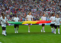 July 26, 2012..Children bring flag of Senegal on to the field before Great Britain vs Senegal Football match during 2012 Olympic Games at Old Trafford in Manchester, England. Senegal held Great Britain to a 1-1 draw...(Credit Image: © Mo Khursheed/TFV Media)