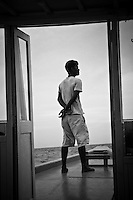 A Dohni crew member stands watch at the bow in the Maldives (Wednesday, June 10th, 2009). Photo: joliphotos.com