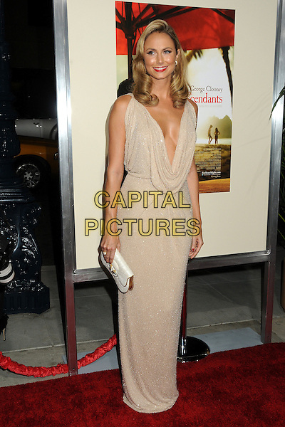 Stacy Keibler.Premiere of 'The Descendants' held at The Academy of Motion Pictures, Arts & Sciences in Beverly Hills, California, USA..November 15th, 2011.full length beige cream dress cowl neck low cut plunging neckline cleavage clutch bag white .CAP/ADM/BP.©Byron Purvis/AdMedia/Capital Pictures.
