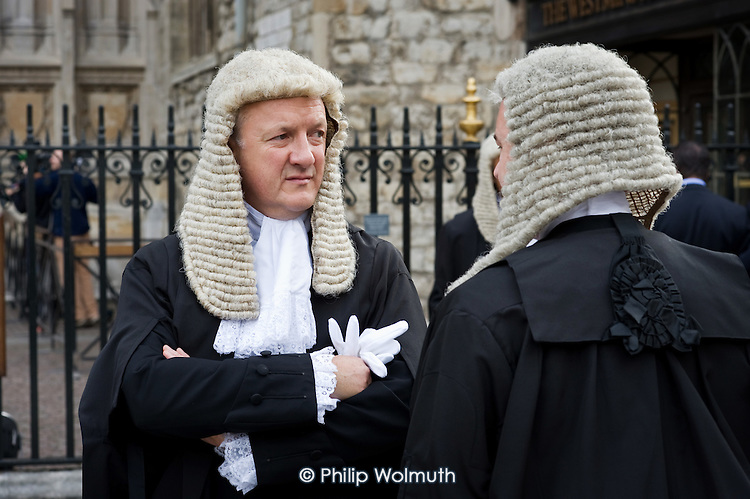 Judges wait outside Westminster Abbey before a service to mark the start of the new legal year in England and Wales