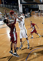 Florida International University center Brandon Moore (22) plays against Troy University, which won the game 75-70 in overtime on February 23, 2012 at Miami, Florida. .