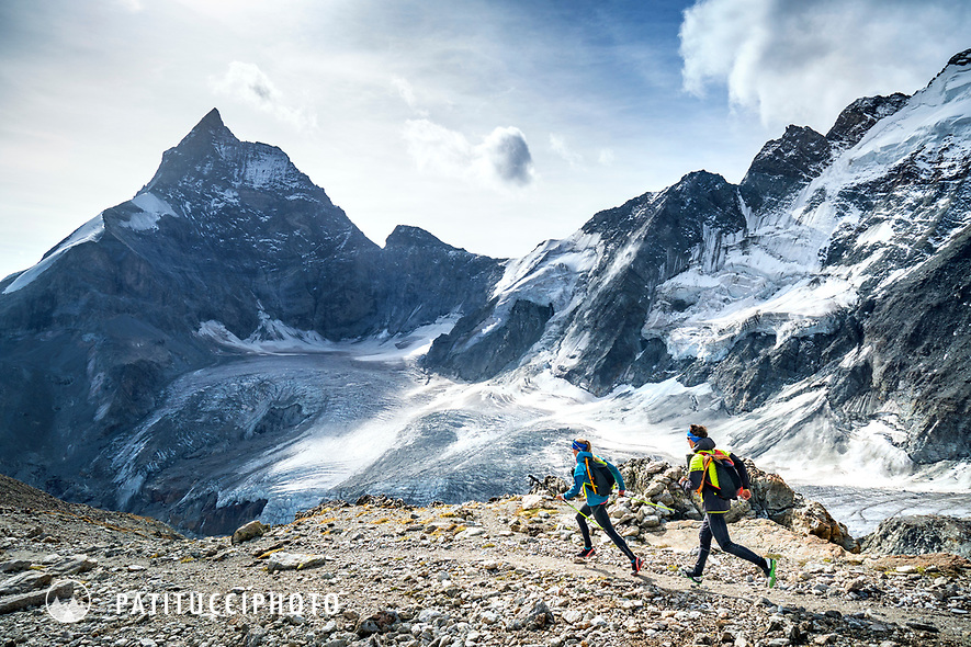 The Chamonix to Zermatt Glacier Haute Route. In late August 2017, we ran the tour in mountain running gear, running shoes, and all the necessary glacier travel and crevasse rescue gear. On the last day, after leaving the Stockjigletscher, the route is all trails and mostly running all the way to Zermatt, with the Matterhorn and Dent d'Hérens in the background.