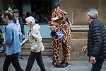 © Joel Goodman - 07973 332324 . 28/05/2017 . Manchester , UK . Two runners dressed in giraffe costumes hug and cry at the finish line . The Great Manchester Run 2017 . Security is still heightened in Manchester following a murderous bomb attack at an Ariana Grande gig at Manchester Arena on Monday 22nd May . Photo credit : Joel Goodman