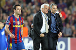 Football - FC Barcelona v Inter Milan UEFA Champions League Semi Final Second Leg - Camp Nou Stadium, Barcelona, Spain - 28/4/10 Inter Milan's coach Jose Mourinho celebrating after winning the match and Xavi Hernandez of Barcelona