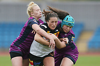 Picture by Paul Currie/SWpix.com - 07/10/2017 - Rugby League - Women's Super League Grand Final - Bradford Bulls v Featherstone Rovers - Regional Arena, Manchester, England - Kirsty Moroney of Bradford Bulls is tackled by Georgia Roche of Featherstone Rovers and Jas Hazzel