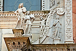 Detail of statues on the Cathedral facade on Piazza Duomo in Como, Italy on Lake Como