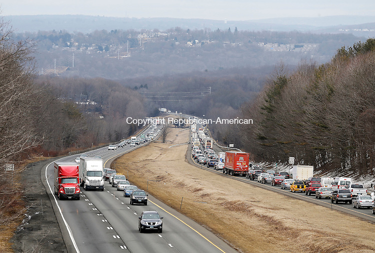 Middlebury, CT- 27 March 2015-032715CM01-  Traffic is seen from the South Street bridge on Interstate 84 in Middlebury on Friday.  A tractor trailer was involved in an accident near exit 17.   Christopher Massa Republican-American