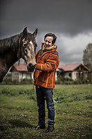 Miguel Tapia, former percussionist of the Chilean rock group Los Prisioneros, cares his horse Relampago in his farm in Pirque, Chile, October 2012...Photo by Roberto Candia