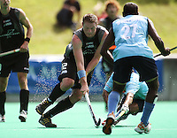 NZ's Bradley Shaw takes the ball up during the international hockey match between the New Zealand Black Sticks and India at National Hockey Stadium, Wellington, New Zealand on Saturday, 20 February 2009. Photo: Dave Lintott / lintottphoto.co.nz