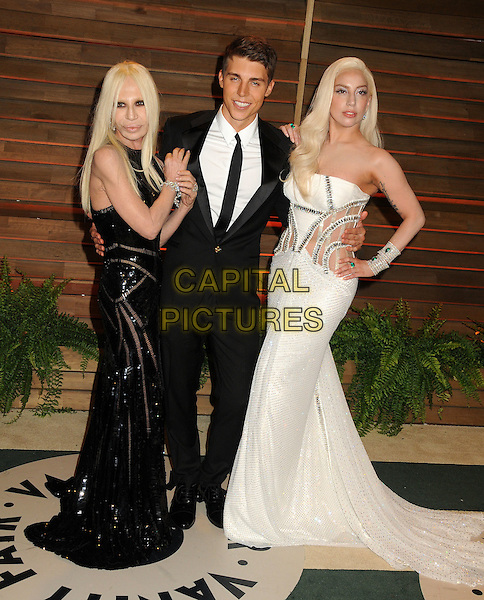 02 March 2014 - West Hollywood, California - Donatella Versace, Nolan Funk, Lady Gaga (Stefani Joanne Angelina Germanotta). 2014 Vanity Fair Oscar Party following the 86th Academy Awards held at Sunset Plaza.  <br /> CAP/ADM/BP<br /> &copy;Byron Purvis/AdMedia/Capital Pictures