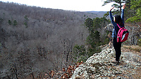 NWA Democrat-Gazette/FLIP PUTTHOFF<br />Thao Nguyen of Fayetteville marvels at the panorama Dec. 1 2017 at Pedestal Rocks Scenic Area. Two loop trails offer four miles of hiking along stunning cliff and boulder formations, plus a 114-foot waterfall during wet times.
