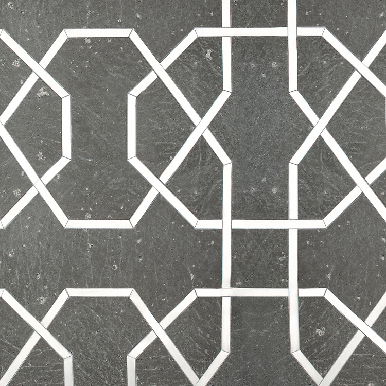 Collins, a waterjet stone mosaic, shown in Basalto and brushed Aluminum, is part of the Trove collection for New Ravenna.