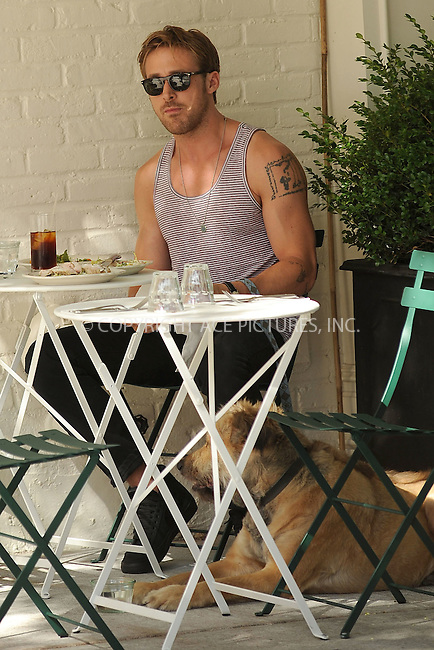 WWW.ACEPIXS.COM . . . . . .July 14, 2011...New York City... Ryan Gosling eating  on the Lower East Side on July 14, 2011 in New York City....Please byline: KRISTIN CALLAHAN - ACEPIXS.COM.. . . . . . ..Ace Pictures, Inc: ..tel: (212) 243 8787 or (646) 769 0430..e-mail: info@acepixs.com..web: http://www.acepixs.com .