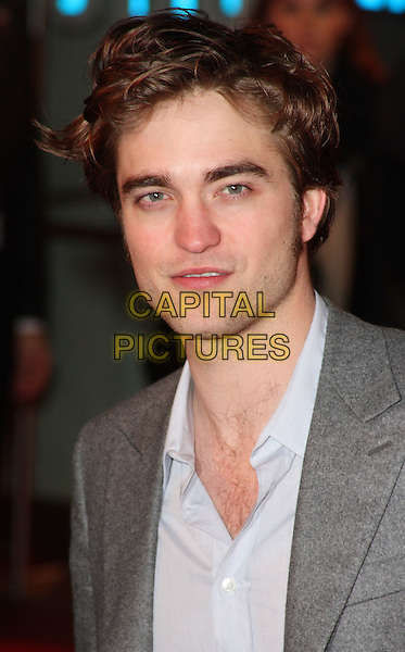ROBERT PATTINSON.UK Premiere of 'Remember Me' held at the Odeon Leicester Square, London, England..March 17th 2010.headshot portrait grey gray blue shirt rob .CAP/ROS.©Steve Ross/Capital Pictures.