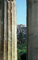 Seen through the columns of the Roman Agora in an old section of Athens, the Parthenon dominates the hill of the Acropolis.