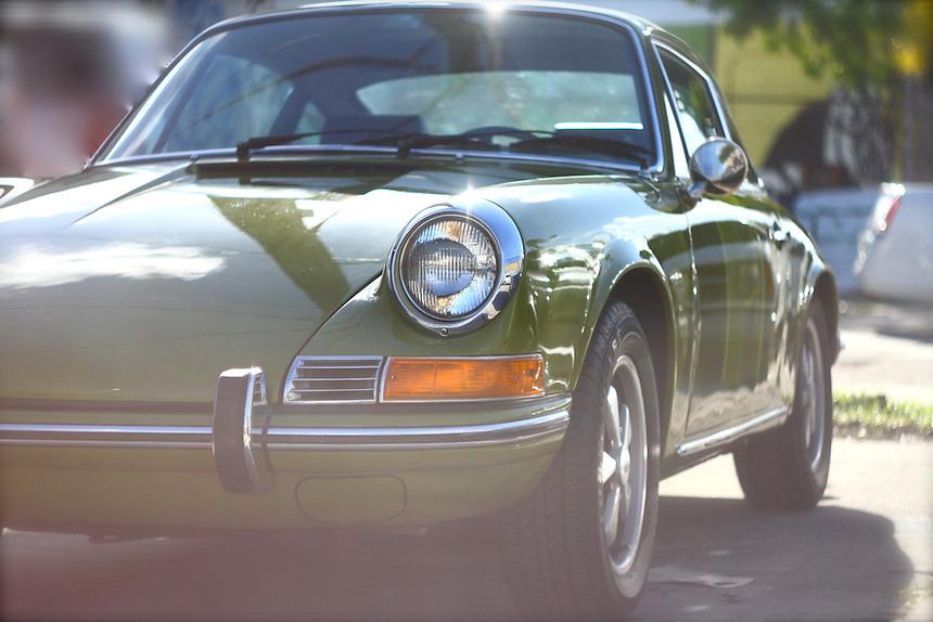 olive green Porsche 912 on a sunlit miami street