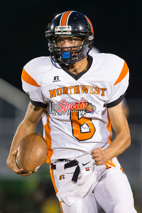 Chris Monteleone (6) of the Northwest Cabarrus Trojans runs with the football during first half action against the Carson Cougars at Jesse Carson High School on October 24, 2014, in China Grove, North Carolina.  The Cougars defeated the Trojans 35-6.  (Brian Westerholt/Sports On Film)