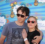 SANTA MONICA, CA. - March 14: Stephen Moyer and Anna Paquin attend the Make-A-Wish Foundation's Day of Fun hosted by Kevin & Steffiana James held at Santa Monica Pier on March 14, 2010 in Santa Monica, California.