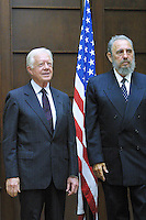 Cuban President Fidel Castro and former US President Jimmy Carter shake hands during the official welcome in the State Counsil, att the  first day of Carters six day visit to Cuba,on May12, 2002. Credit: Jorge Rey/MediaPunch