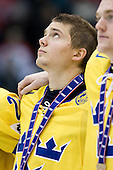 Jacob Josefson (Sweden - 10) - Team Sweden celebrates after defeating Team Switzerland 11-4 to win the bronze medal in the 2010 World Juniors tournament on Tuesday, January 5, 2010, at the Credit Union Centre in Saskatoon, Saskatchewan.