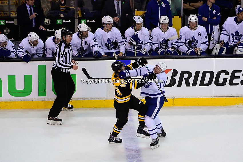 April 21, 2018: Boston Bruins right wing David Pastrnak (88) and Toronto Maple Leafs center Zach Hyman (11) battle at the blue line during game five of the first round of the National Hockey League's Eastern Conference Stanley Cup playoffs between the Toronto Maple Leafs and the Boston Bruins held at TD Garden, in Boston, Mass. Toronto defeats Boston 4-3, Boston leads Toronto 3 games to 2 in the best of 7 series.
