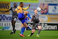 Lincoln City's Danny Rowe vies for possession with Mansfield Town's Krystian Pearce<br /> <br /> Photographer Chris Vaughan/CameraSport<br /> <br /> The EFL Sky Bet League Two - Mansfield Town v Lincoln City - Monday 18th March 2019 - Field Mill - Mansfield<br /> <br /> World Copyright © 2019 CameraSport. All rights reserved. 43 Linden Ave. Countesthorpe. Leicester. England. LE8 5PG - Tel: +44 (0) 116 277 4147 - admin@camerasport.com - www.camerasport.com