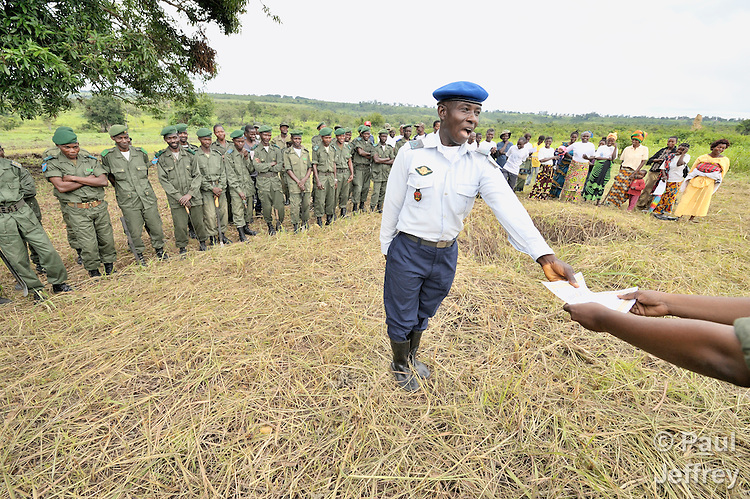 A man receives a certificate of graduation from an agricultural training program on a military base near Kamina, in the Democratic Republic of the Congo. Sponsored by the United Methodist Committee on Relief, the program teaches military personnel and their families agricultural skills that will allow them to support themselves, thus lessening problems of adjustment to life after military service.