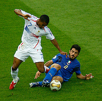 Jul 9, 2006; Berlin, GERMANY; Italy midfielder (8) Gennaro Gattuso tackles France midfielder (7) Florent Malouda during first half play in the final of the 2006 FIFA World Cup at the Olympiastadion, Berlin. Mandatory Credit: Ron Scheffler-US PRESSWIRE Copyright © Ron Scheffler