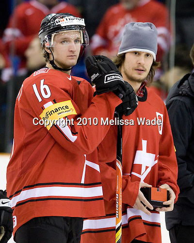 Benjamin Antonietti (Switzerland - 16), Lukas Stoop (Switzerland - 7) - Team Sweden celebrates after defeating Team Switzerland 11-4 to win the bronze medal in the 2010 World Juniors tournament on Tuesday, January 5, 2010, at the Credit Union Centre in Saskatoon, Saskatchewan.